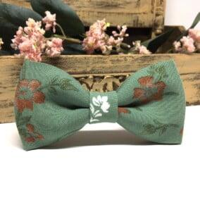 Grøn butterfly med kobber-blomster