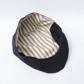 Inderfor i sort sixpence hat i lærredstof